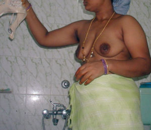 busty desi babe taking shower