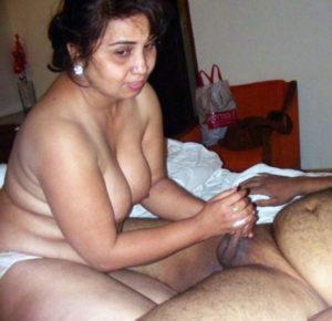 nude babe giving handjob