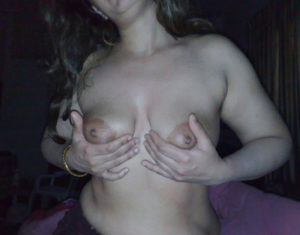 horny aunty touching her breast